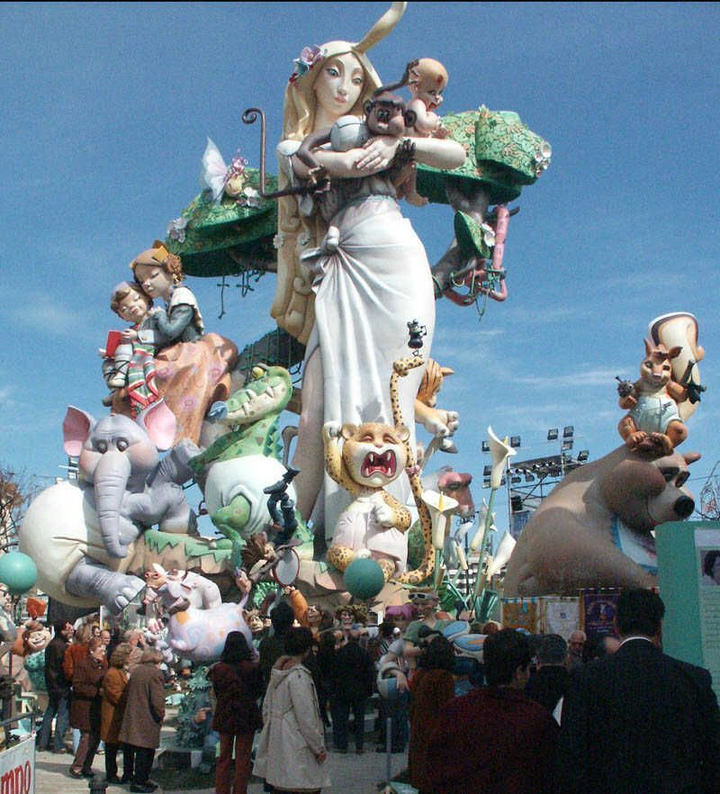 Tourists admire one of the 400 fallas planted around the city of Valencia.