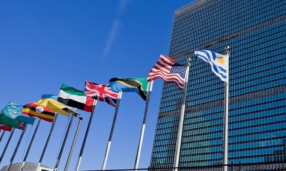 united nations building in nyc and flag poles