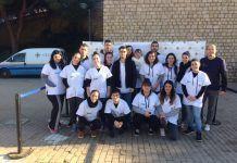 Los alumnos de Fisioterapia en el photo-call de la V Carrera Solidaria CEU