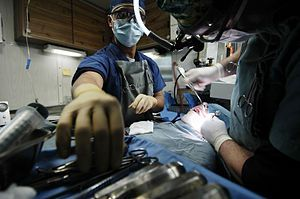 Patient and surgeons in operating theater