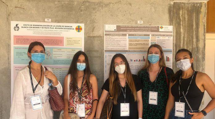 Estudiantes de posgrado en Odontología de la CEU-UCH en la XLIX Reunión anual de CEOE junto a sus trabajos científicos en formato poster.