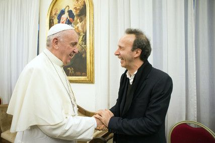 "Pope Francis meets Italian actor Roberto Benigni during a private audience for Pope Francis' book ""The Name of God is Mercy"" at the Vatican, on January 11, 2016. Photo courtesy of REUTERS/Osservatore Romano/Handout via Reuters"