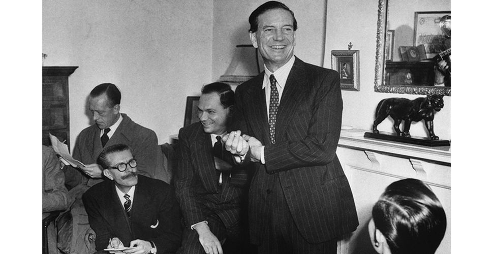 Kim Philby with reporters during the press conference in London, 1955, that cleared him of the charge of tipping off double agents Guy Burgess and Donald Maclean, who had defected to the Soviet Union in 1951