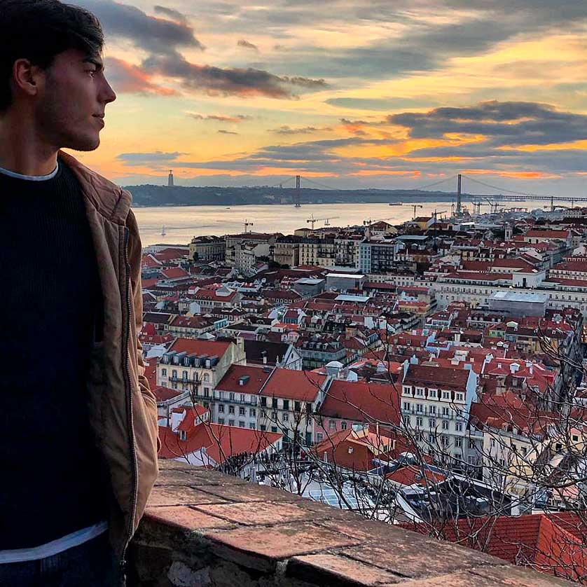 A student overlooking the city of Lisbon