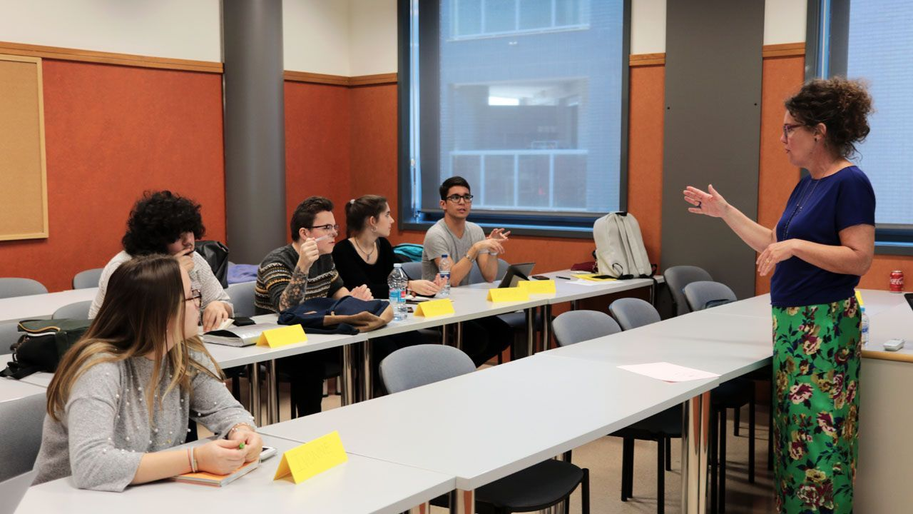 students interacting with professor
